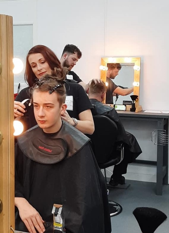 student barbers cutting hair