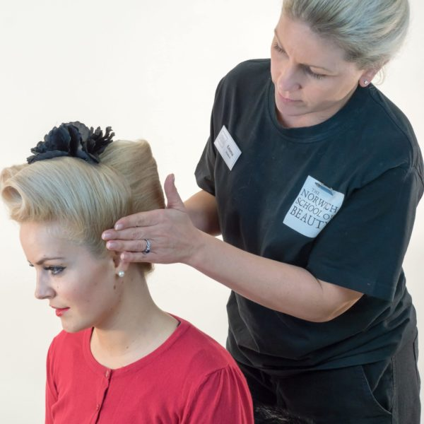 stylist holding head