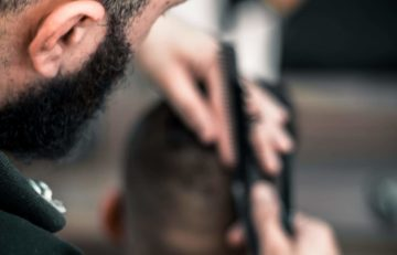 barber student cutting hair