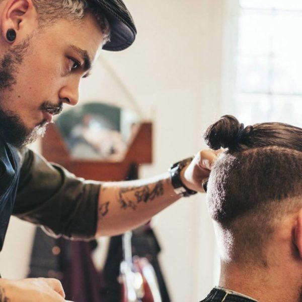 male barber cutting hair