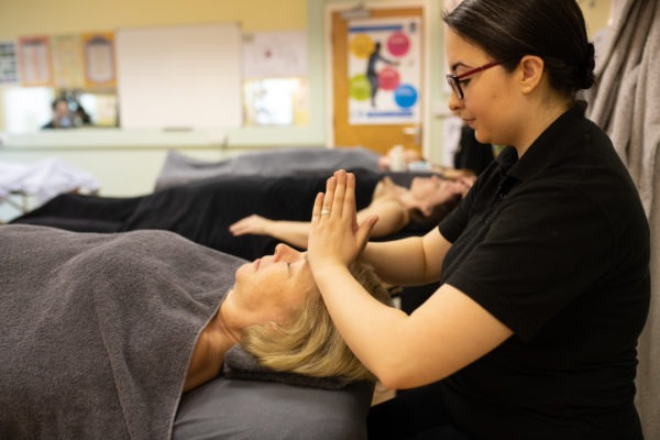 woman laying down having a face massage