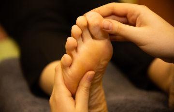 hand holding foot reflexology